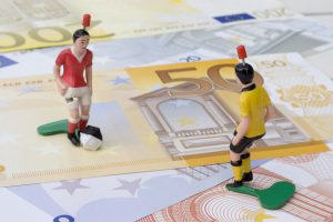 Figures of football players on banknotes